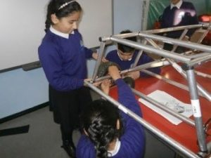 Children assembling the car during kit car club
